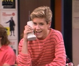Zac from Saved by the Bell with his trademark old school cell phone